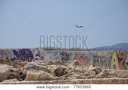 Ryanair Jetliner Approaching Airport And Graffiti