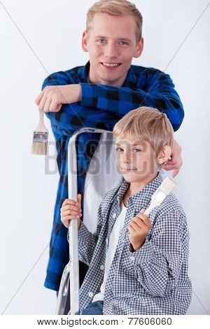 Dad And Son Renovating House