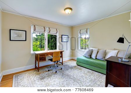 Bright Office Room With Green Couch