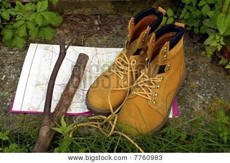 Boots, map and stick