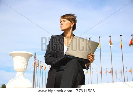 Beautiful business woman with a laptop