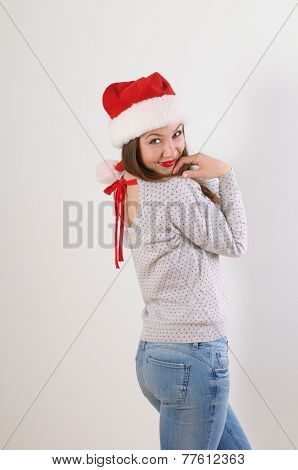 Cute Young Woman In Santa Hat On White Background