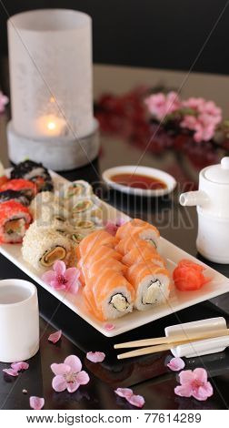 beautifully decorated table with sushi and sake