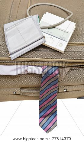Above View Of Sphygmometer On Suitcase With Tie