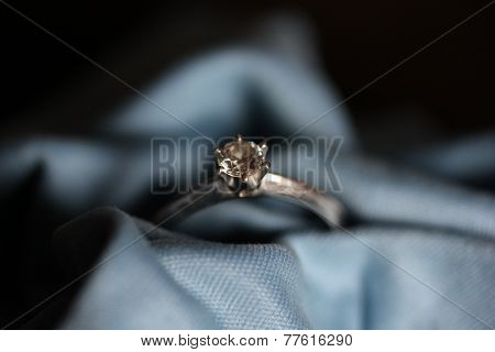 Engagement Ring On A Blue Textile