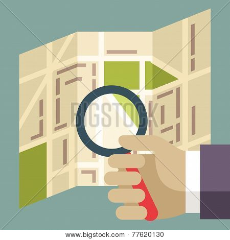 Human Hands Holding Magnifier And Searching Street On The Map