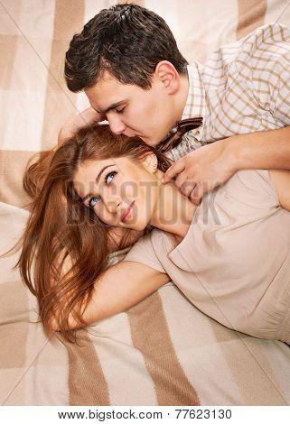 Beautiful Happy Sensual Couple Lying On The Blanket
