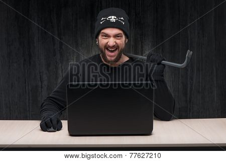Hacker at work with a laptop