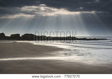 Stunning Sun Rays Bursting From Sky Over Empty Yellow Sand Beach Landscape
