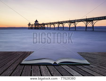 Beautiful Long Exposure Sunset Over Ocean With Pier Silhouette Conceptual Book Image