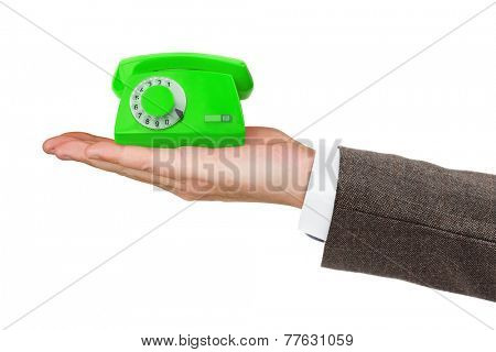 Hand and small telephone isolated on white background