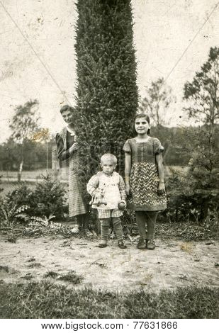GERMANY, CIRCA 1940s: Vintage photo of mother with her children