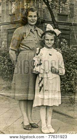 GERMANY, CIRCA 1940s: Vintage photo of mother with her daughter (First Communion)