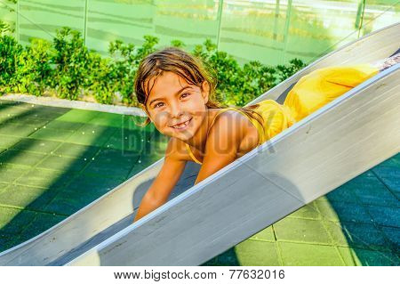 Seven year old girl playing on the playground