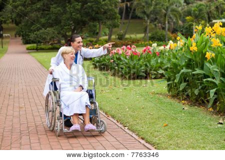 caring young nurse with senior patient