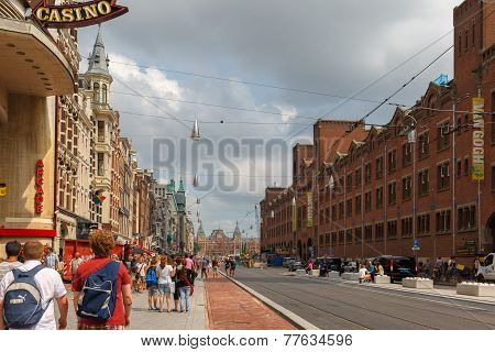 City View Of The Most Famous And Crowded Amsterdam Street Damrak, Holland, Netherlands.