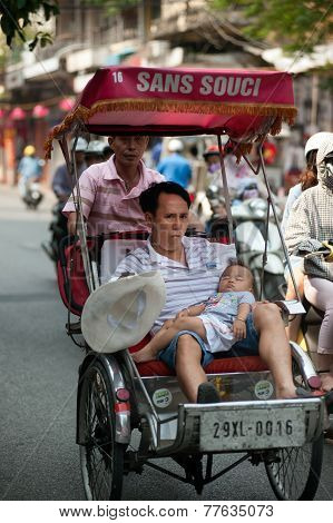 People In The Area Taking A Cyclo Ride In Hanoi,vietnam.