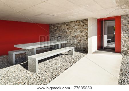 Modern villa, porch with table and bench stone, outdoor