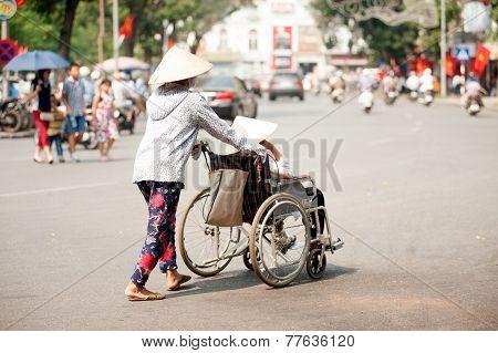 Wheelchair On Street In Hanoi,Vietnam.