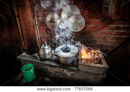 Street Kitchen With Kettle On Open Fire In Vietnam