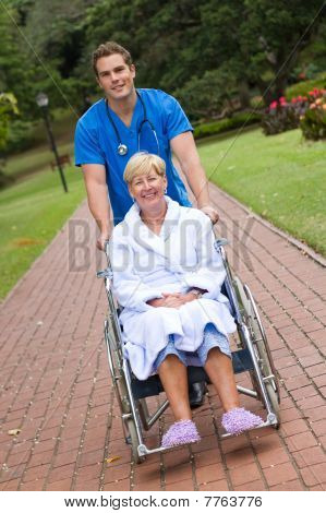 nurse pushing recovering patient