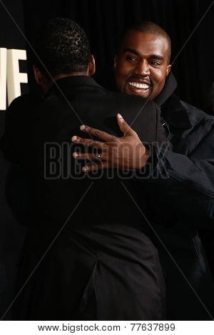 NEW YORK-DEC 3: Comedian/actor Chris Rock (L) hugs Kanye West at the
