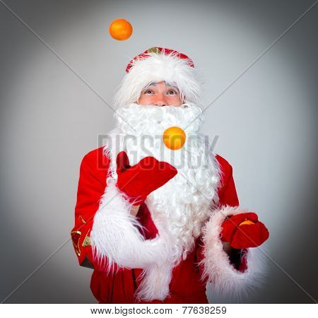 Santa Claus Is Juggling With Tangerines.