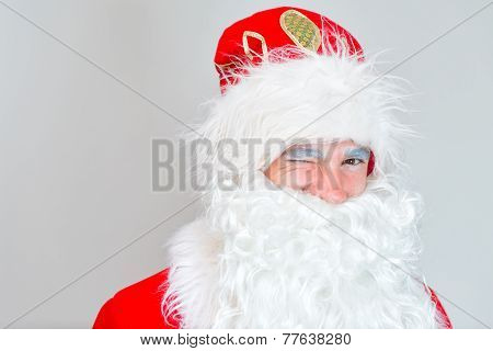 Portrait Of Winking Santa Claus. Place For Your Text.