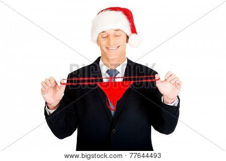 Portrait of santa businessman stretching female thongs.