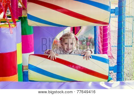 Happy Little Kid On The Playground