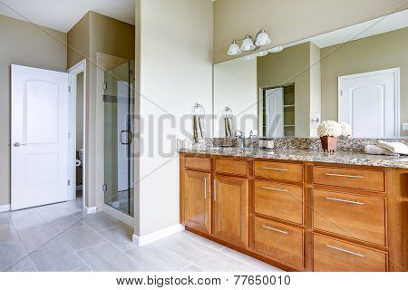 Brown Vanity Cabinet With Granite Top