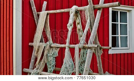 Fishing Nets Blue And Green Hanging On The Fence Or Porch Red, Fishnets Carefully Picked, The Specia