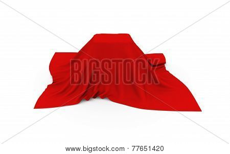 Object of rectangular shape covered with red cloth, on white