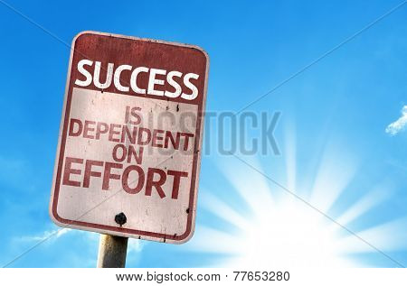 Success is Dependent on Effort sign with sky background