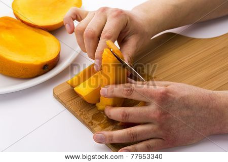 Peeling Off The Fruit Flesh From The Mango Skin