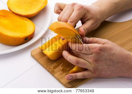 Two Male Hands Peeling A Juicy Mango Fruit Chip