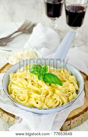 Pasta linguini alfredo with basil selective focus