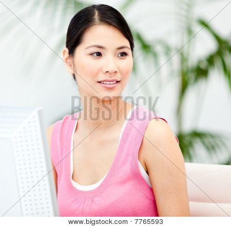 Assertive Businesswoman Working At A Computer