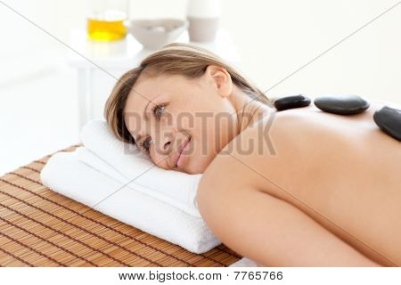 Cute Woman Relaxing On A Massage Table