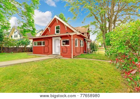 Small Coutnryside House Exterior In Bright Red Color