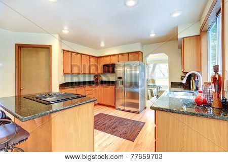 Kitchen Cabinets With Black Granite Top.