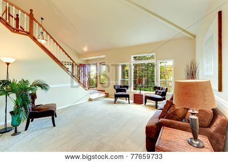 Bright Ivory Living Room With High Vaulted Ceiling And French Window