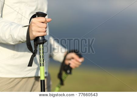 Close Up Of A Hiker Hands Walking With Poles