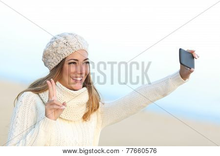 Girl Taking A Selfie With Her Smart Phone In Winter