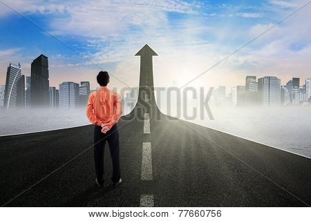 Businessman On The Street Rising Upward