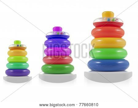 Pyramid Build From Colored  Rings. Toy For Babies And Toddlers To Joyfully Learn Mechanical Skills A