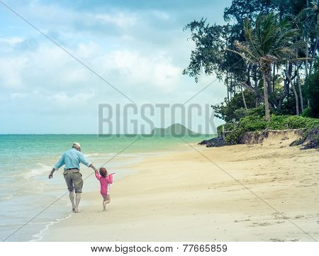 Girl And Grandad At The Beach