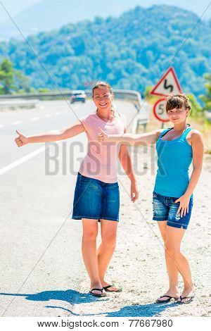Beautiful Girls On The Road Hitchhiking