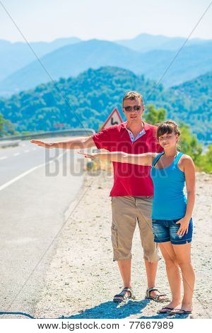 Married Young Couple Hitchhiking Summer Day