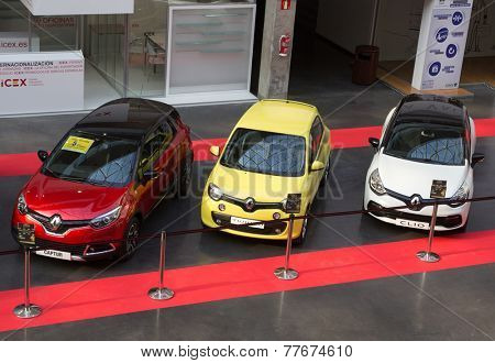 VALENCIA, SPAIN - DECEMBER 4, 2014:  A red Renault Captur, a yellow Renault Twingo and a white Renault Clio at the Valencia Automovil 2014 Car Show. Renault is the third biggest European automaker.